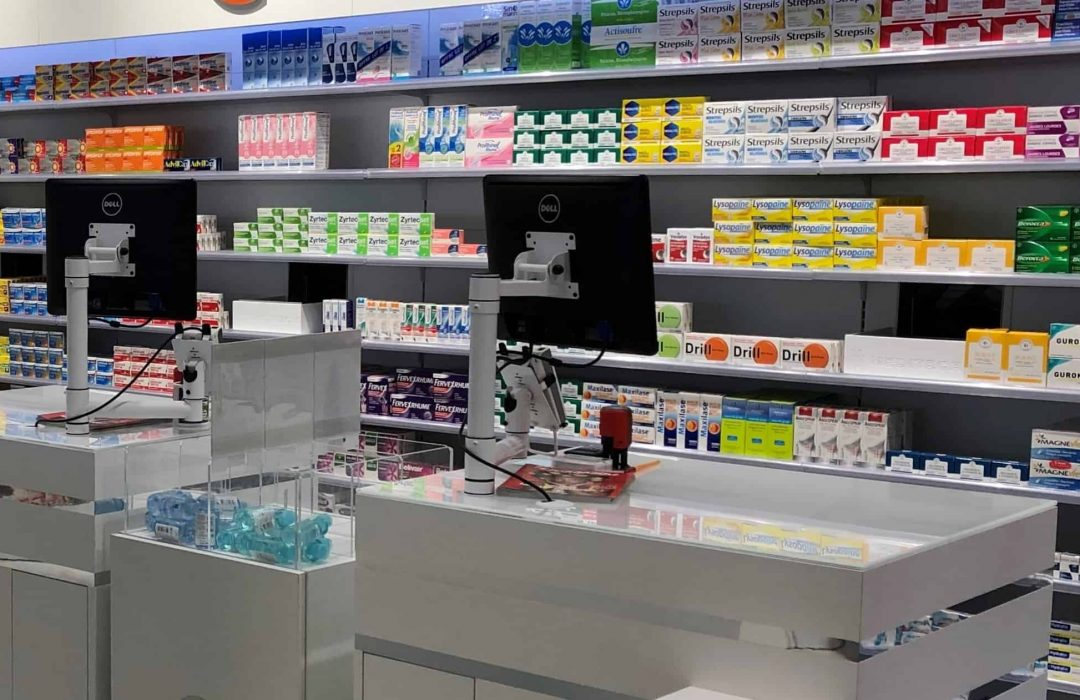 Meditech - OTC Shelving front on with service counter exits
